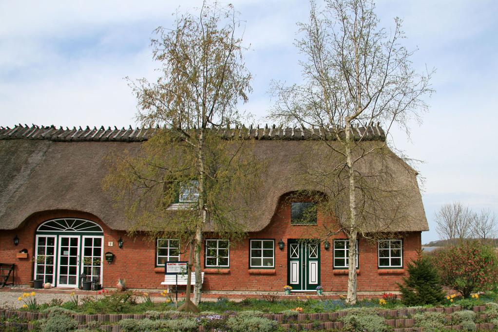 Ihr Eingang ist die Tür des alten Bauernhauses.