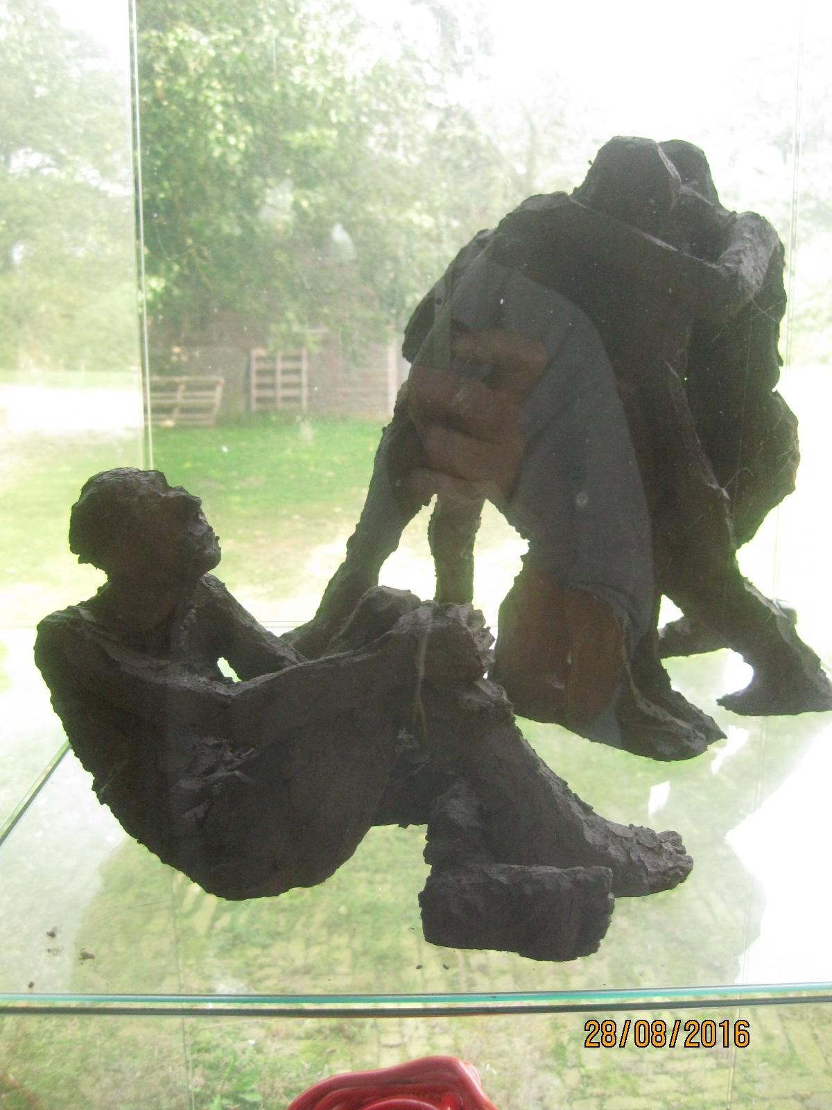 1 figuur en beeld met drie figuren