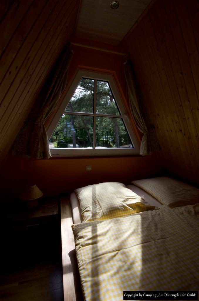 Das 1. Schlafzimmer mit Doppelbett