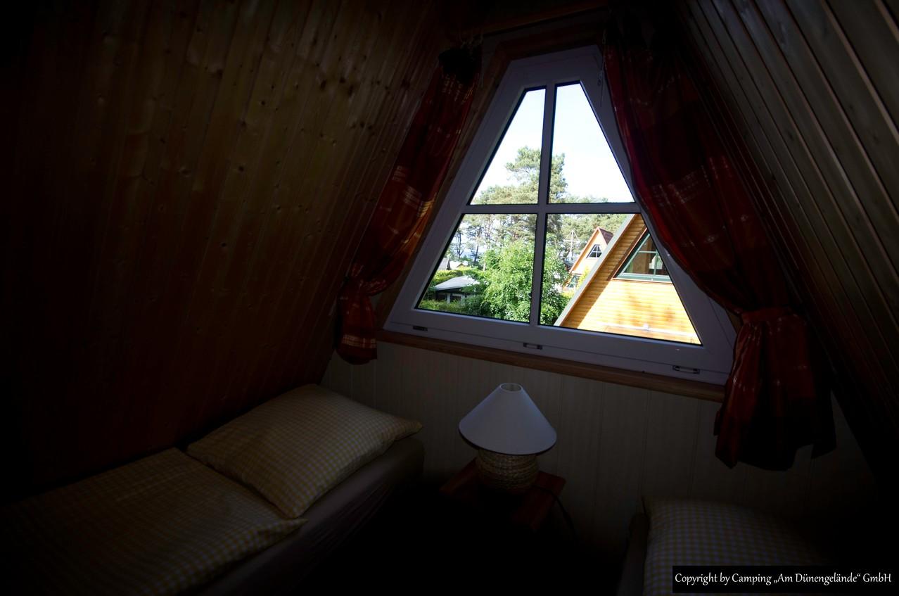 Das 2. Schlafzimmer mit getrennten Betten