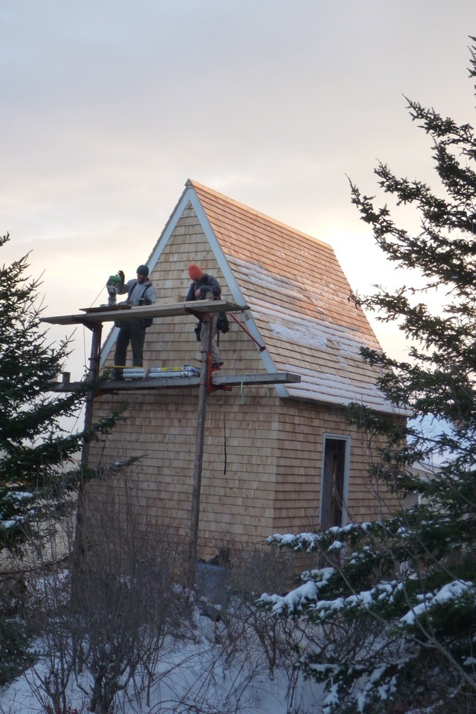 Mark and Rusty cut the last few shingles on the chilly north side