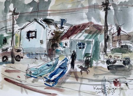神奈川県・真鶴港の漁船と建物