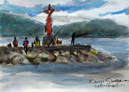 小田原市・小さな赤い灯台と釣り人