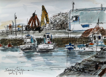 神奈川県・魚市場近くの堤防と船
