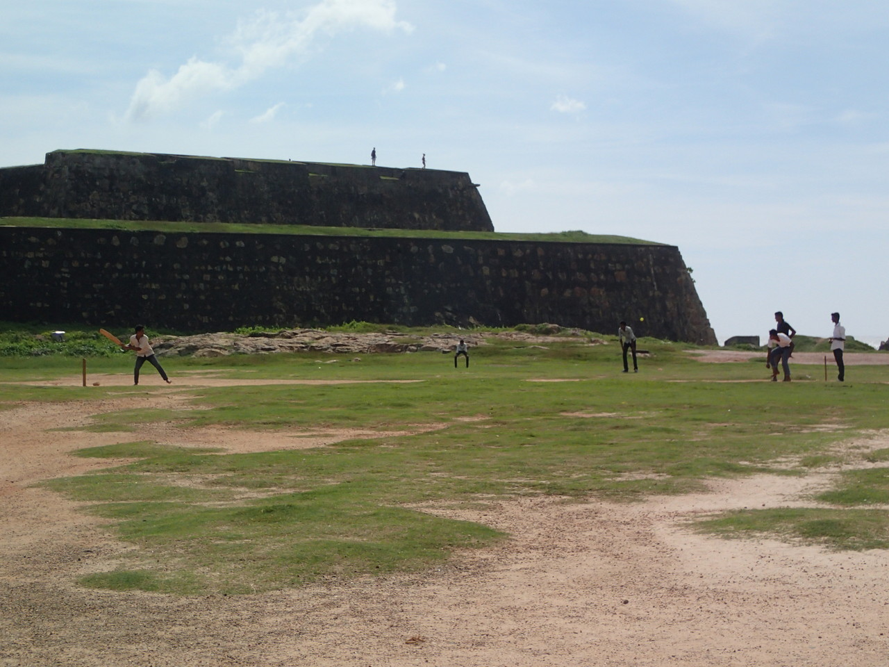 guys playing cricket in front of the Galle fort