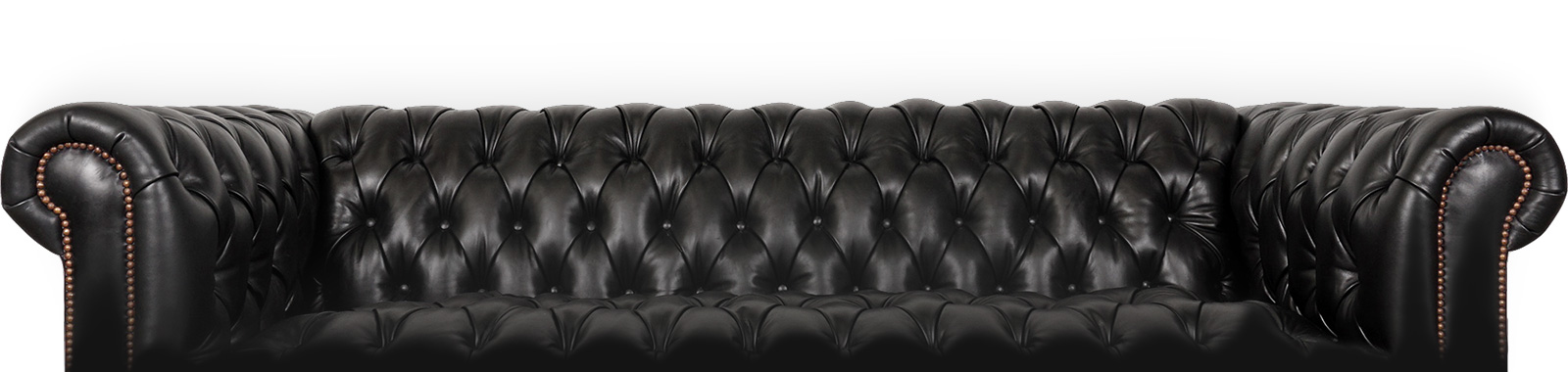 Black couch with metal rivets along arms