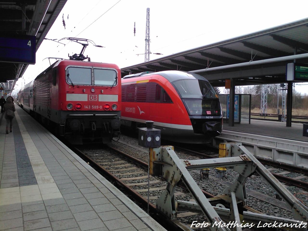 642 548 & 143 589-0 Im Bahnhof Rostock am 3.2.13