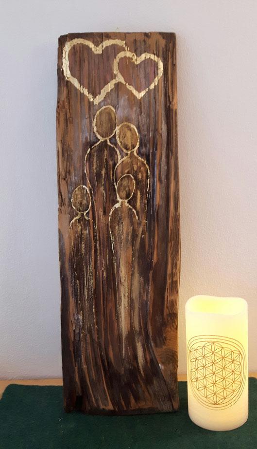 Familienbild auf alter Holzschindel