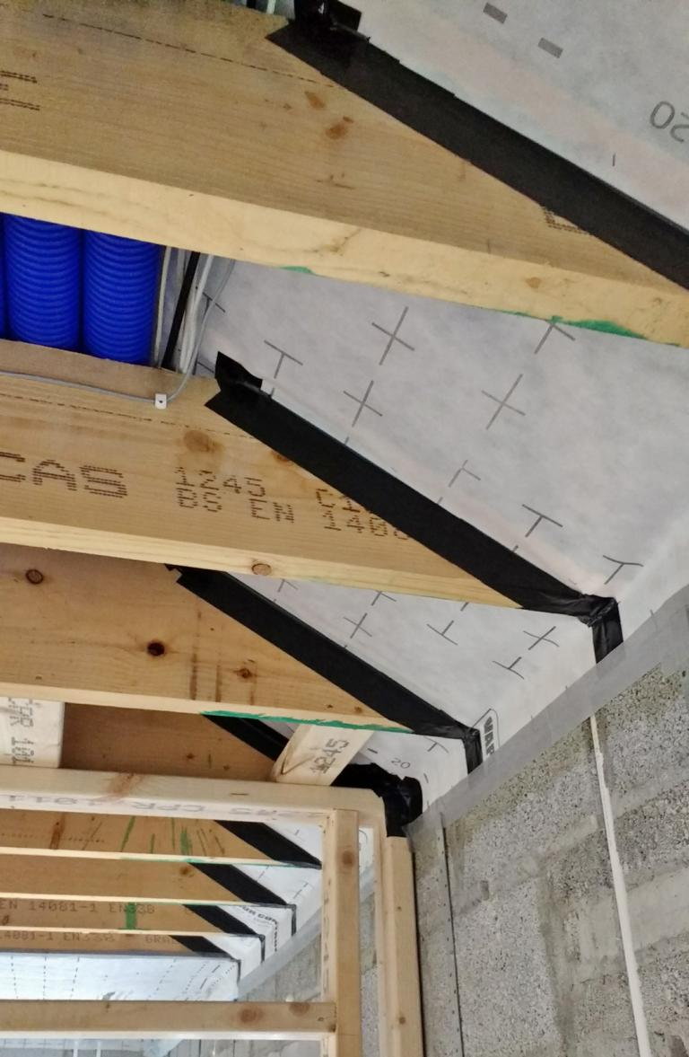 Detail of Vapour Control Membrane Installation through ceiling joists