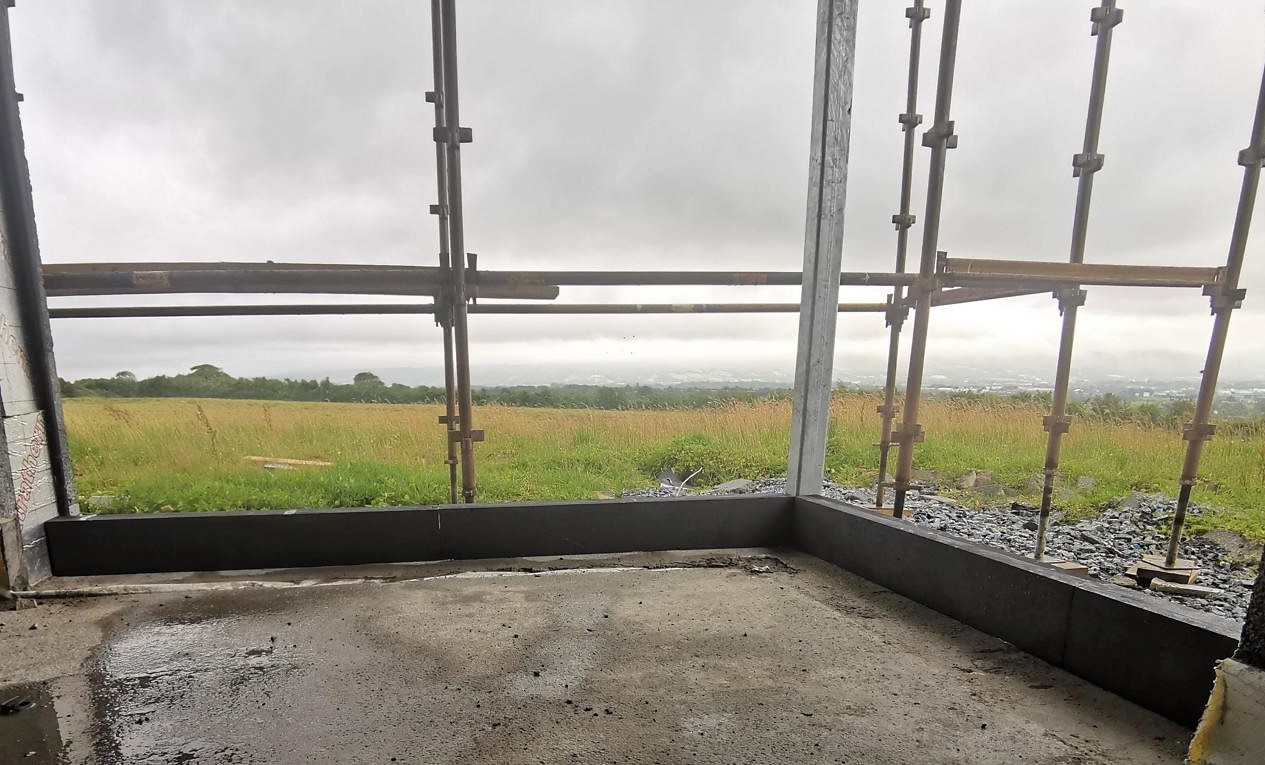 The thermal window brackets in this photo will secure a massive corner window area, extending over two storeys.