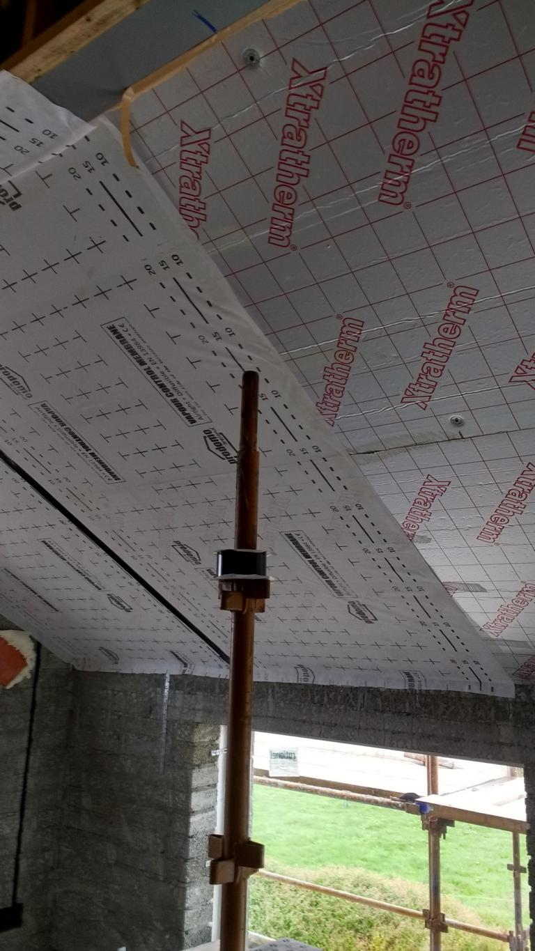 Installation of air tightness membrane right against rigid insulation without staples