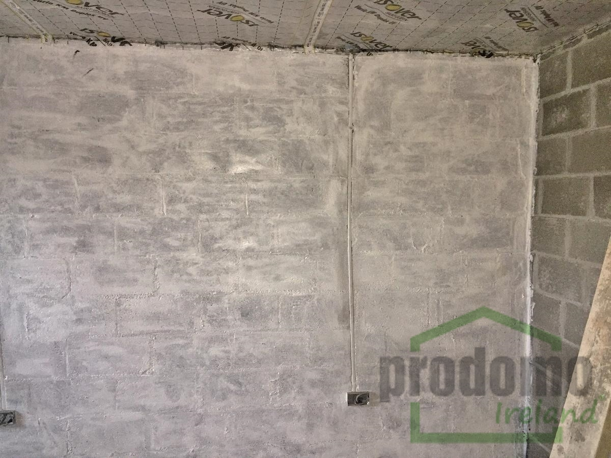 Air Tight Paint to create an air tight layer before installing insulated slabs to exterior walls