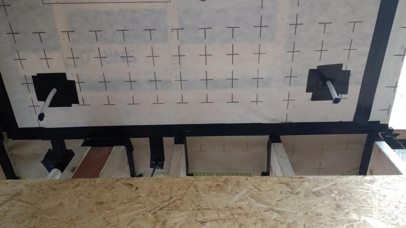 Air Tight Membrane connected through the floor joists