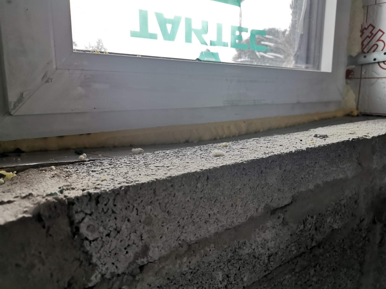 To keep the DPC tight against the cill & window frame, when the windows have been installed already, just fill expanding foam between the horizontal cavity wall closer and the DPC