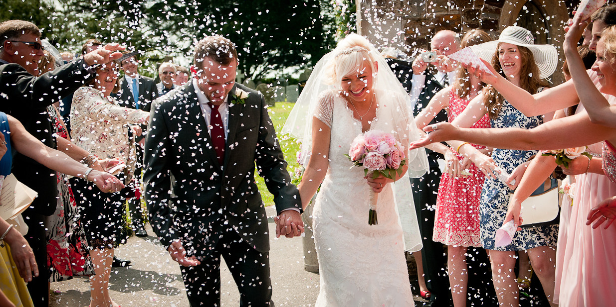 confetti outside church on wedding day in North Devon