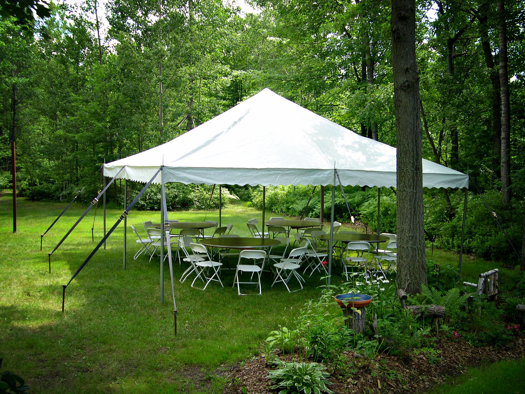20 x 20 Pole tent with 4 round tables and 32 chairs