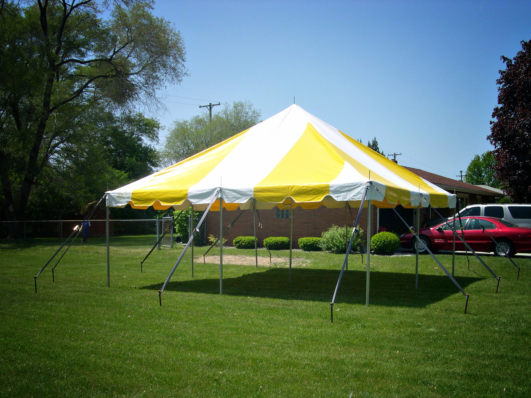 20 x 20 Pole tent can seat up to 48 people with 6 banquet tables
