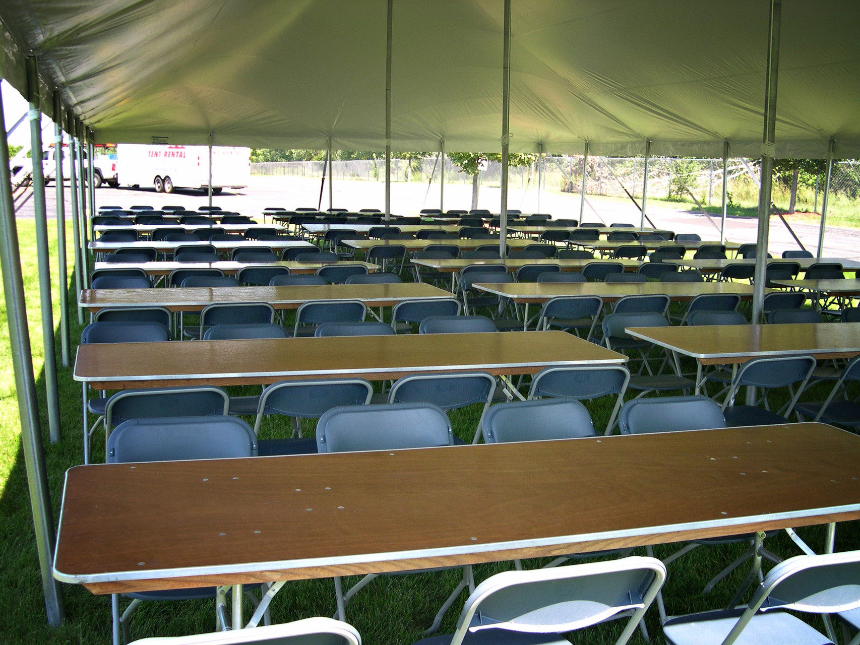 30 x 60 Pole tent with 24 tables and 192 chairs