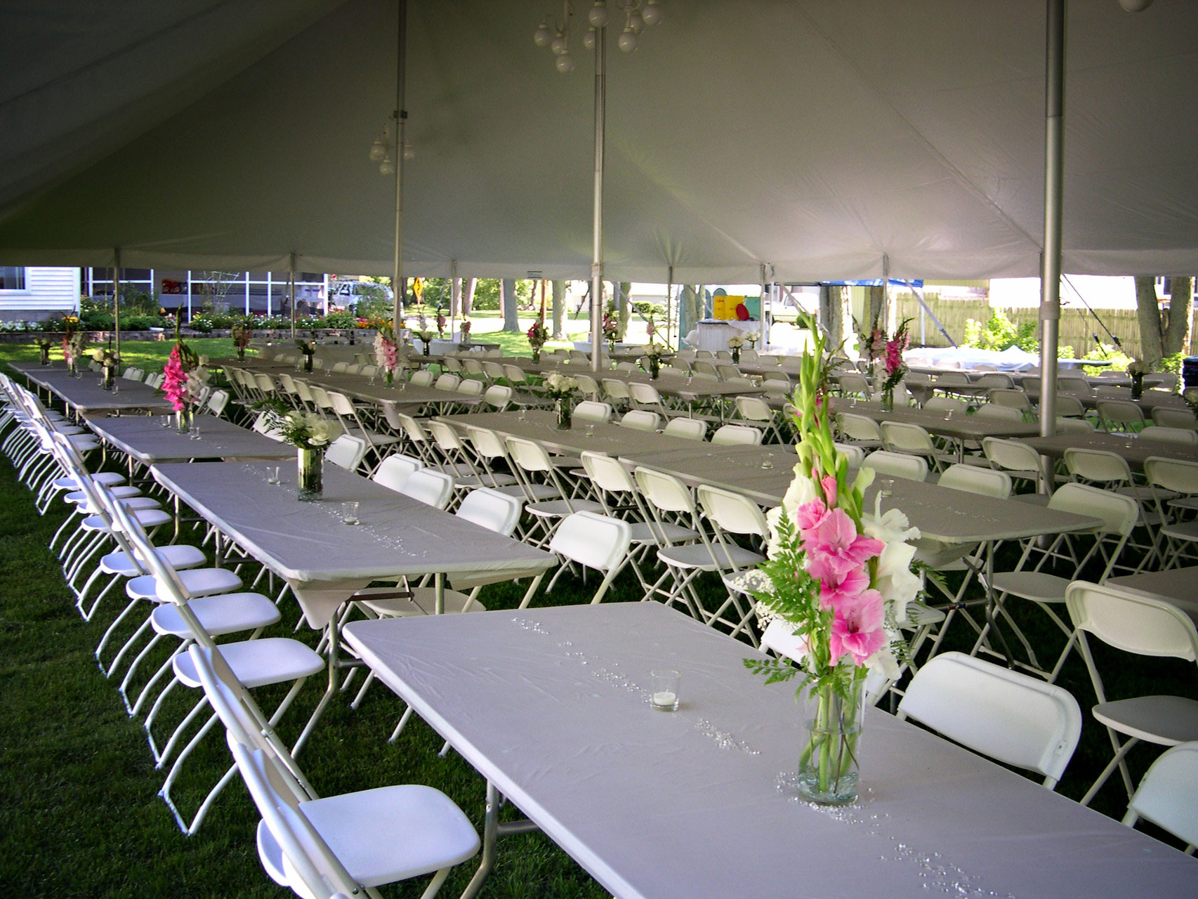 40 x 80 Wedding tent, 8ft banquet tables, white chairs and chandeliers