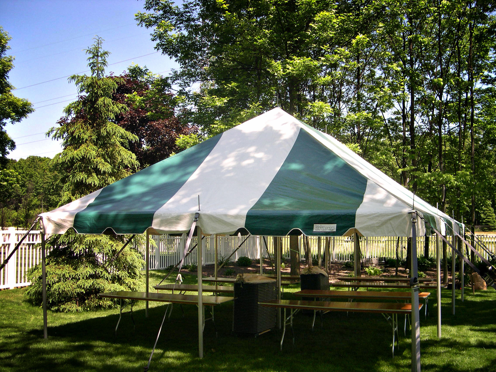 20 x 30 Pole tent with 8 tables and 64 chairs