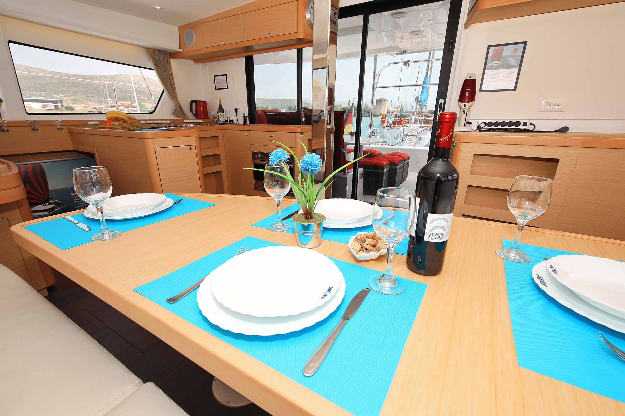 Catamaran Lagoon 42 Salon with decorated table: Ready for Booking offshoresailing  journeys