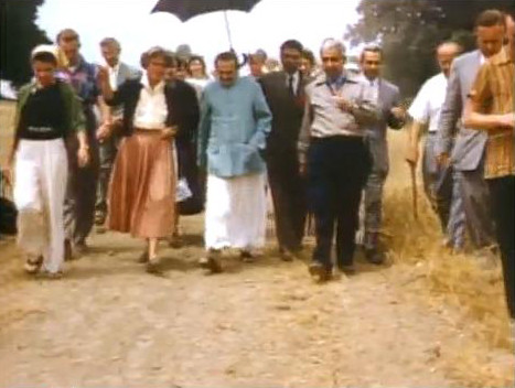 Meher Mount 1956 ; Adi K Irani on Baba's right with Eruch holding the umbrella. 1956 :  Image captured by Anthony Zois from a film by Sufism Reoriented