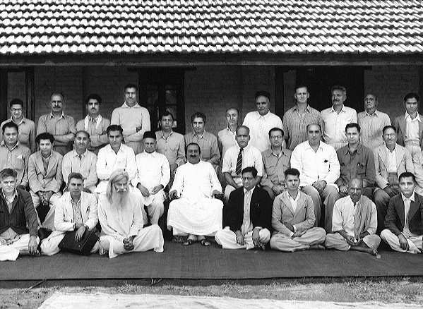 Meher Baba with his male followers. Babadas is seated in the front row.