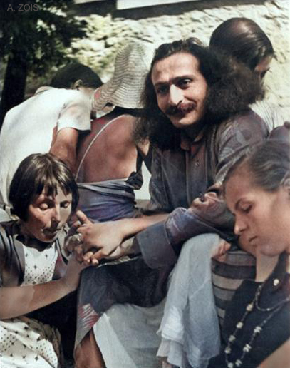 1934 : Meher Baba in Zurich at Hedi Merten's home ( seated ) & her daughter. Image colourized by Anthony Zois.