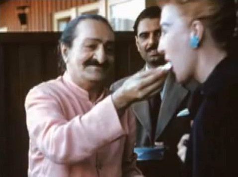 1958 ; Holiday Lodge Hotel, San Francisco, USA. Baba giving sweets to Marion with Eruch Jessawala looking on.