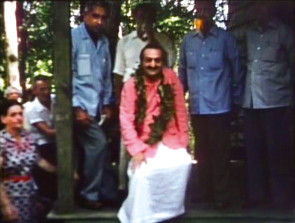 Carrie standing on the left of Meher Baba at the Myrtle Beach Centre, SC.