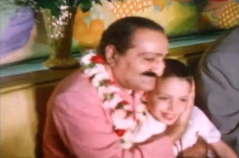 Meher Baba embracing a young Larry Karrasch. Image captured by Anthony Zois from a film by Sufism Reoriented.