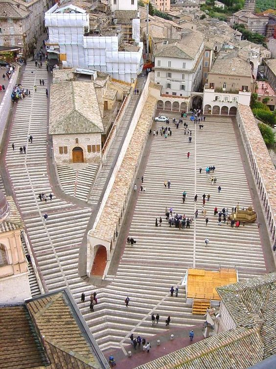 Basilica of St. Francis of Assisi. Aerial view of the pilgrim courtyard outside the church entrance.