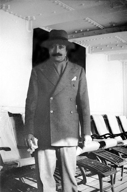 Mid 1930s on board a ship - Meher Baba incognito wearing a Western suit.