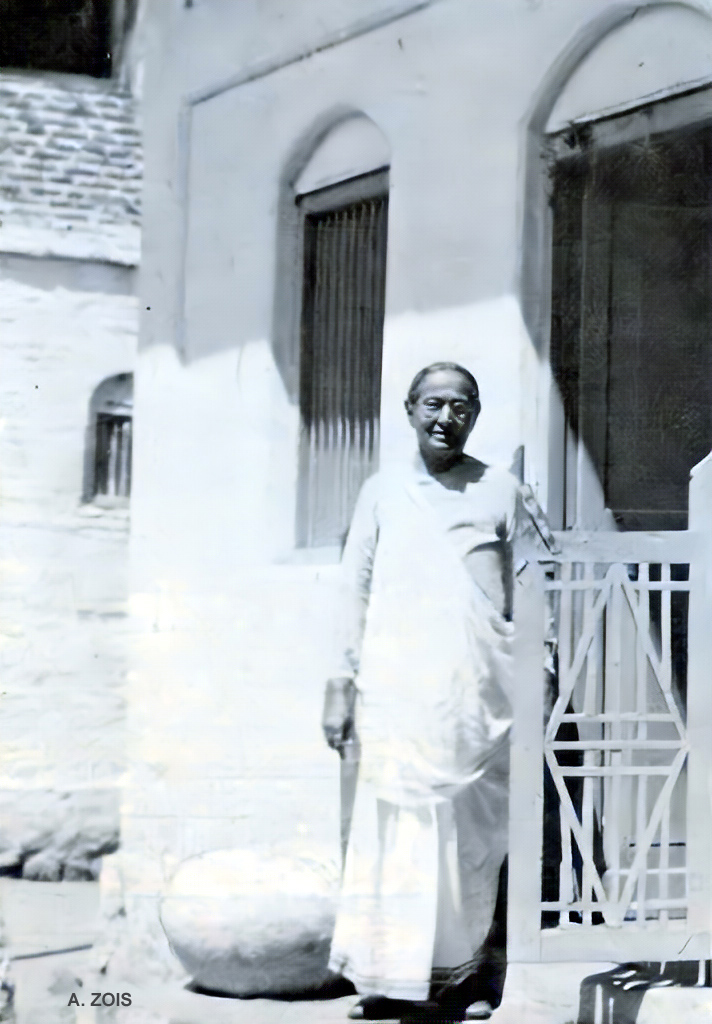 Shireen seen at the doorway of Pumpkin House, Poona. Original photo.