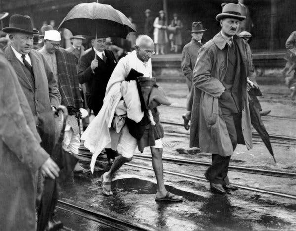 1931 : Folkstone, England. Gandhi walking from the ferry to a waiting car to take him to London. WINTER !