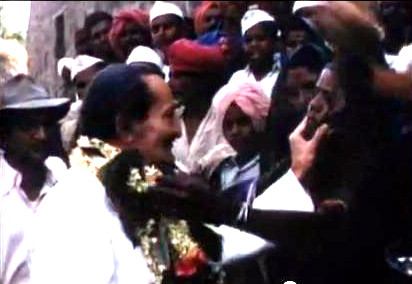 Baba being garlanded by a local woman