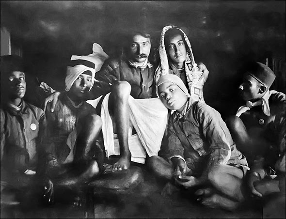 Meher Baba with some of the boys from the Hazrat Babajan School near the crypt. Chhota Baba is seated to the right of Baba and Agha Ali is is front of Baba leaning his head.