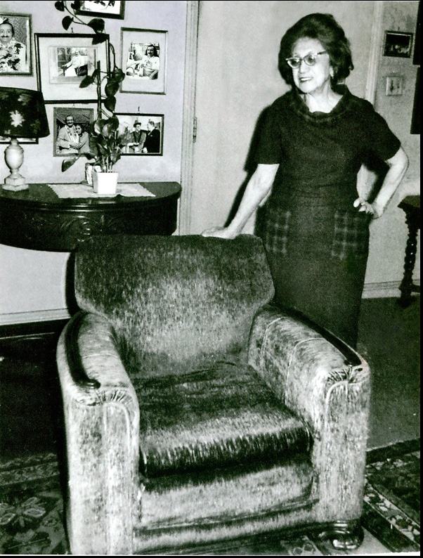 Hilda Fuchs with the arm-chair that Meher Baba sat in during his visit to California. This chair is now at the Meher Archives in Asheville, NC.