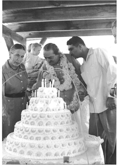 1958 : Meher Baba at the Meher Center, Myrtle Beach, SC.  Baba is holding Eruch Jessawala's hand for support. Kitty Davy is pointing out some details of the cake. In the background is Harold Rudd holding his son Raphael. Joseph Harb is on the far right.