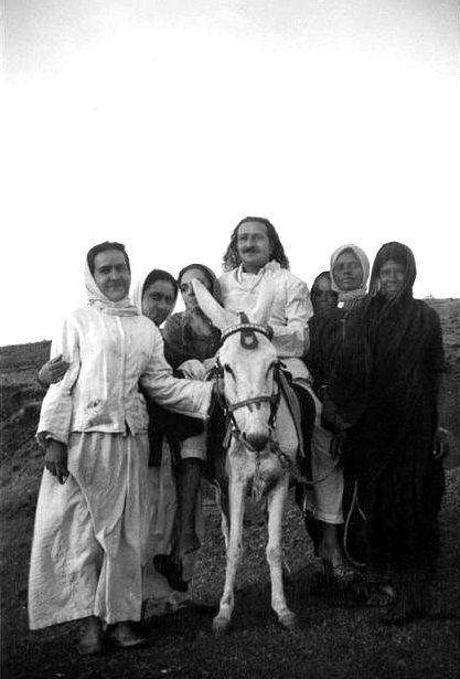 8th July 1936 : Meher Baba on his donkey. Valu is 2nd from the right.