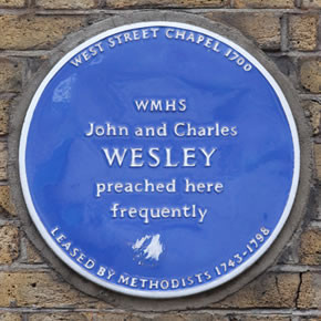 Historic plaque on the exterior wall of 26 West Street