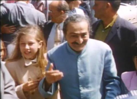 "Diane ( 13y.o.) with Meher Baba at Coit Tower over-looking San Francisco harbour - Standing behind Baba are Fred Winterfeldt (l) & Fred Frey(r) - image excerpts from ""Meher Baba's Grace"""