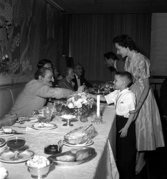 Annarosa and her son Larry meet Meher Baba at Longchamps restaurant in 1956.