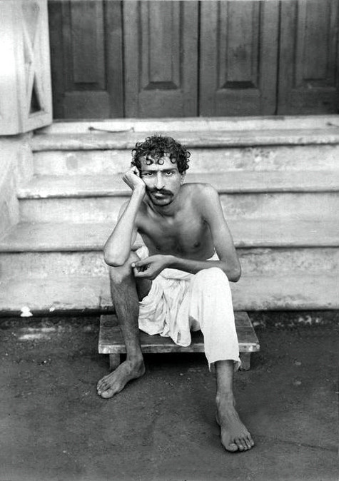 Meher Baba sitting on the steps of Manzil-e-Meem in 1922 - Courtesy of MN Collection