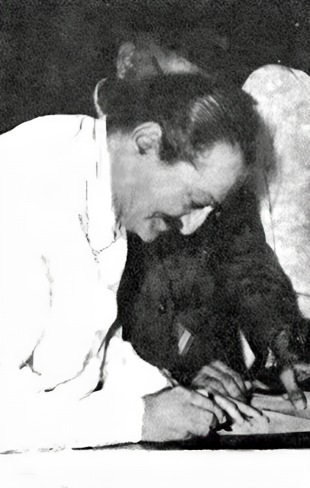 Baba signing His passport in India 1950s