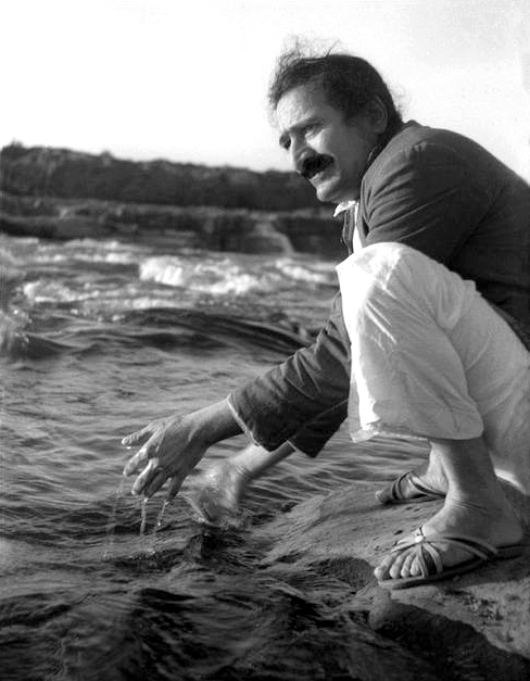 December 25, 1938 - Meher Baba at the Narmada River, Marble Rocks, near Jabulpur, India. Photo taken by Rano Gayley.