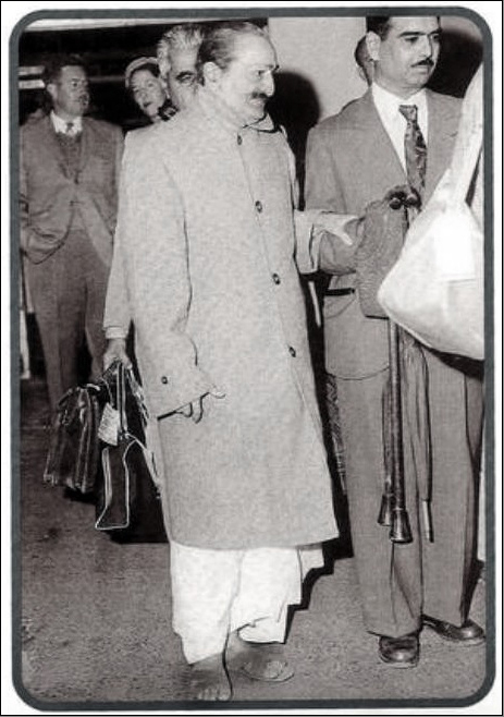 Meher Baba with Eruch Jessawala & Adi K. Irani ( behind ) arriving at Brisbane Airport.