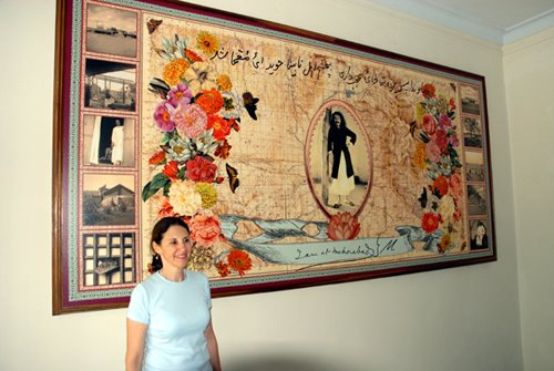 Beth Ganz in front of her composition (digitally created) in the Dining Hall at Meherabad, India
