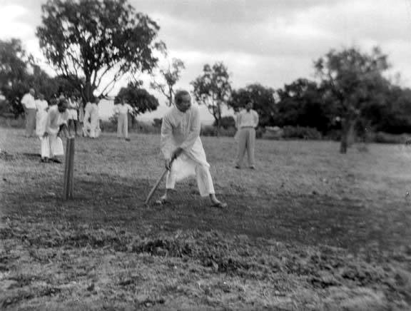 1956 Satara ; Meher Baba batting, he played for both sides. This game was prior to the car accident.