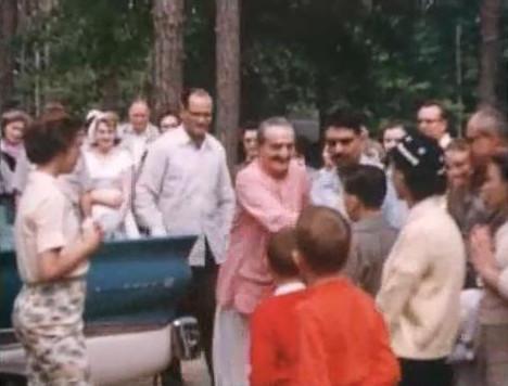 Baba with Nariman Dadachanji standing behind him